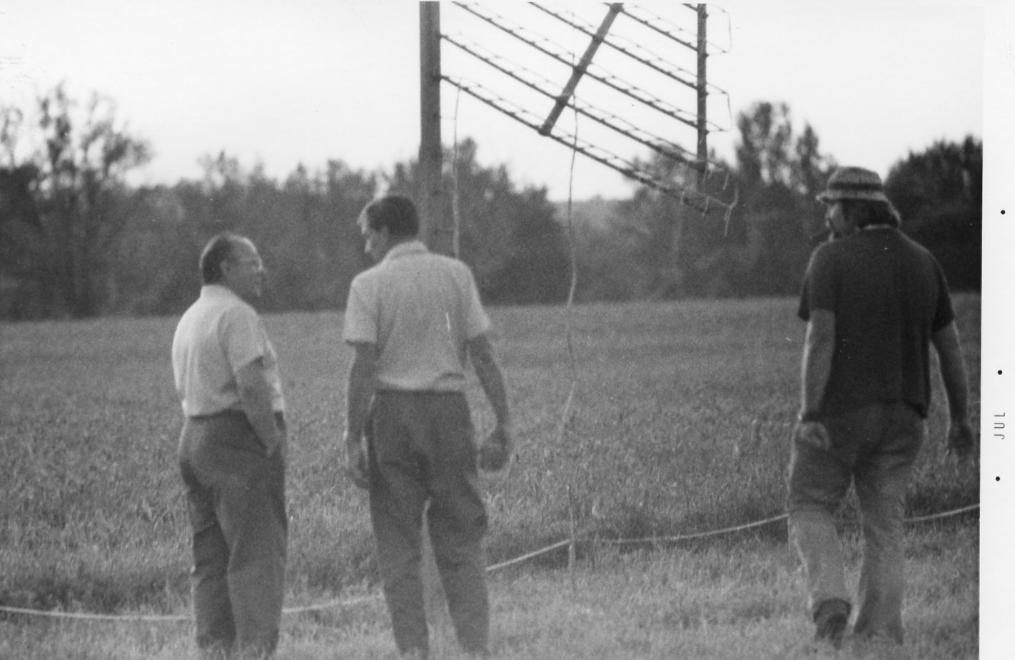 3 men standing in front of american flag firework