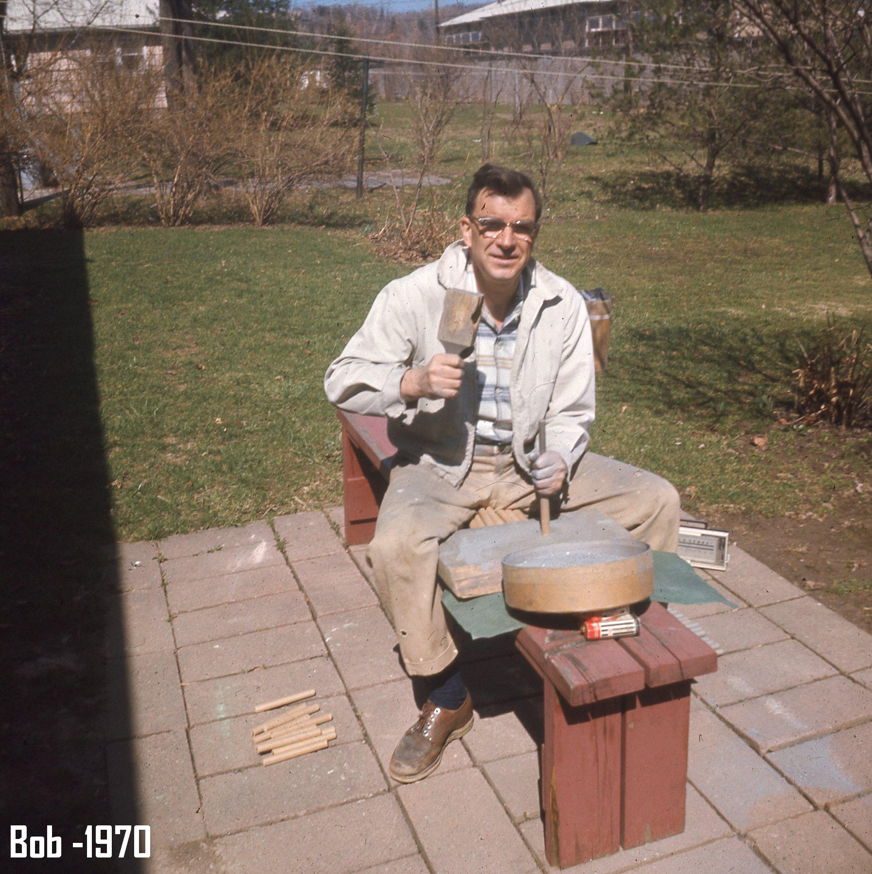 robert young holding tools assembling fireworks in yard