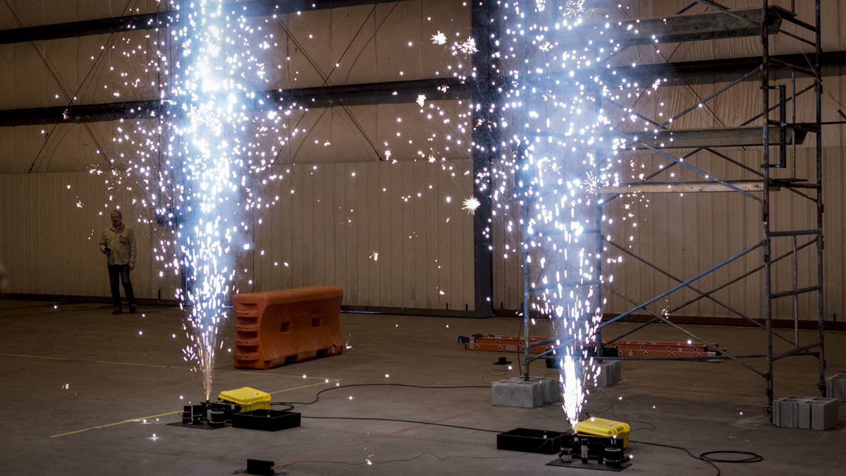 two large indoor fireworks with electronic firing panels