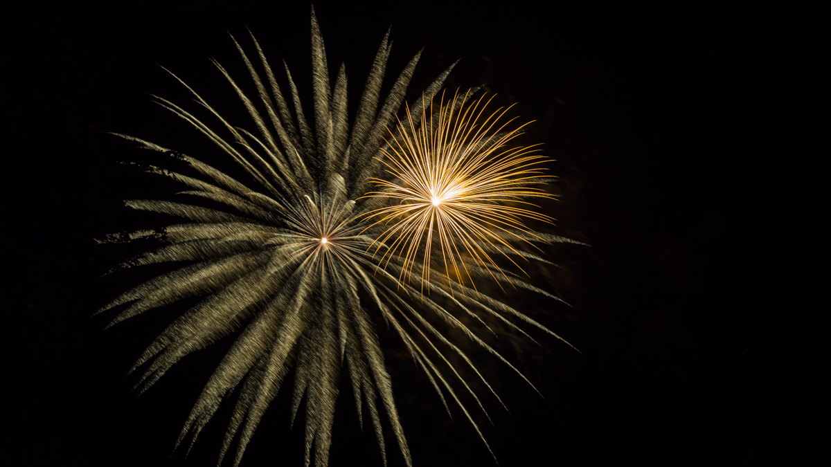 two gold fireworks