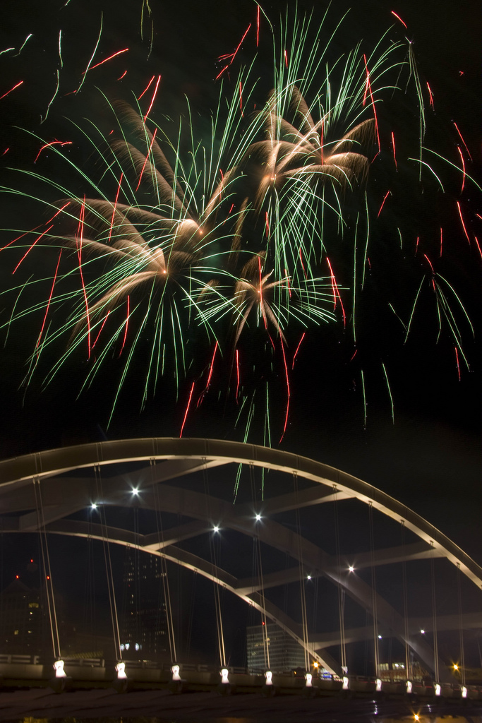 green fireworks over bridge