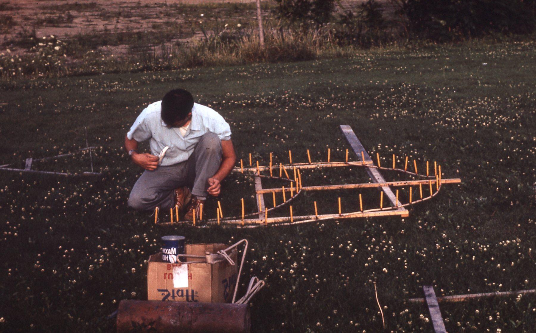 man assembling fireworks on ground