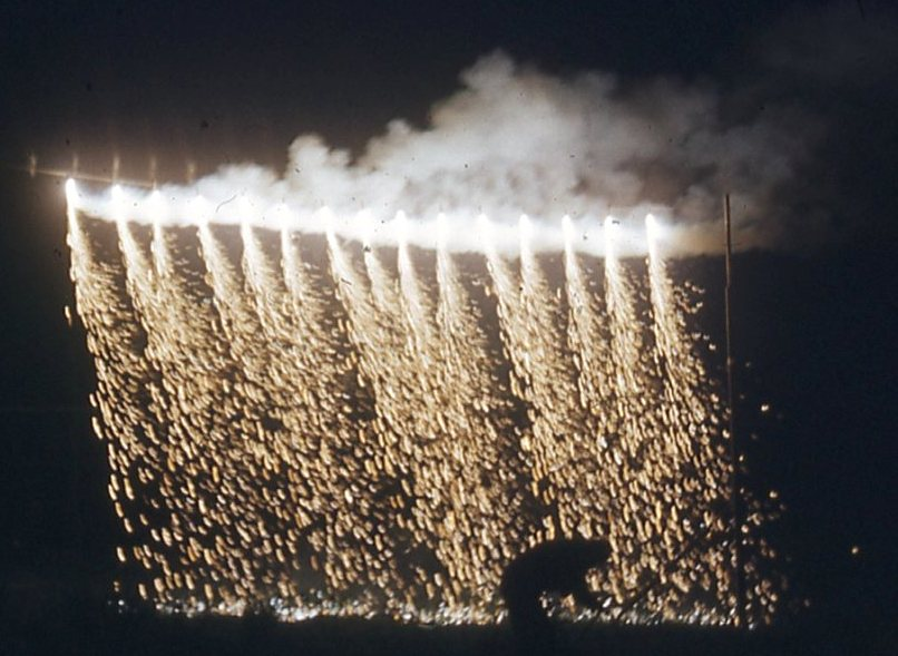 fireworks waterfall with person underneath