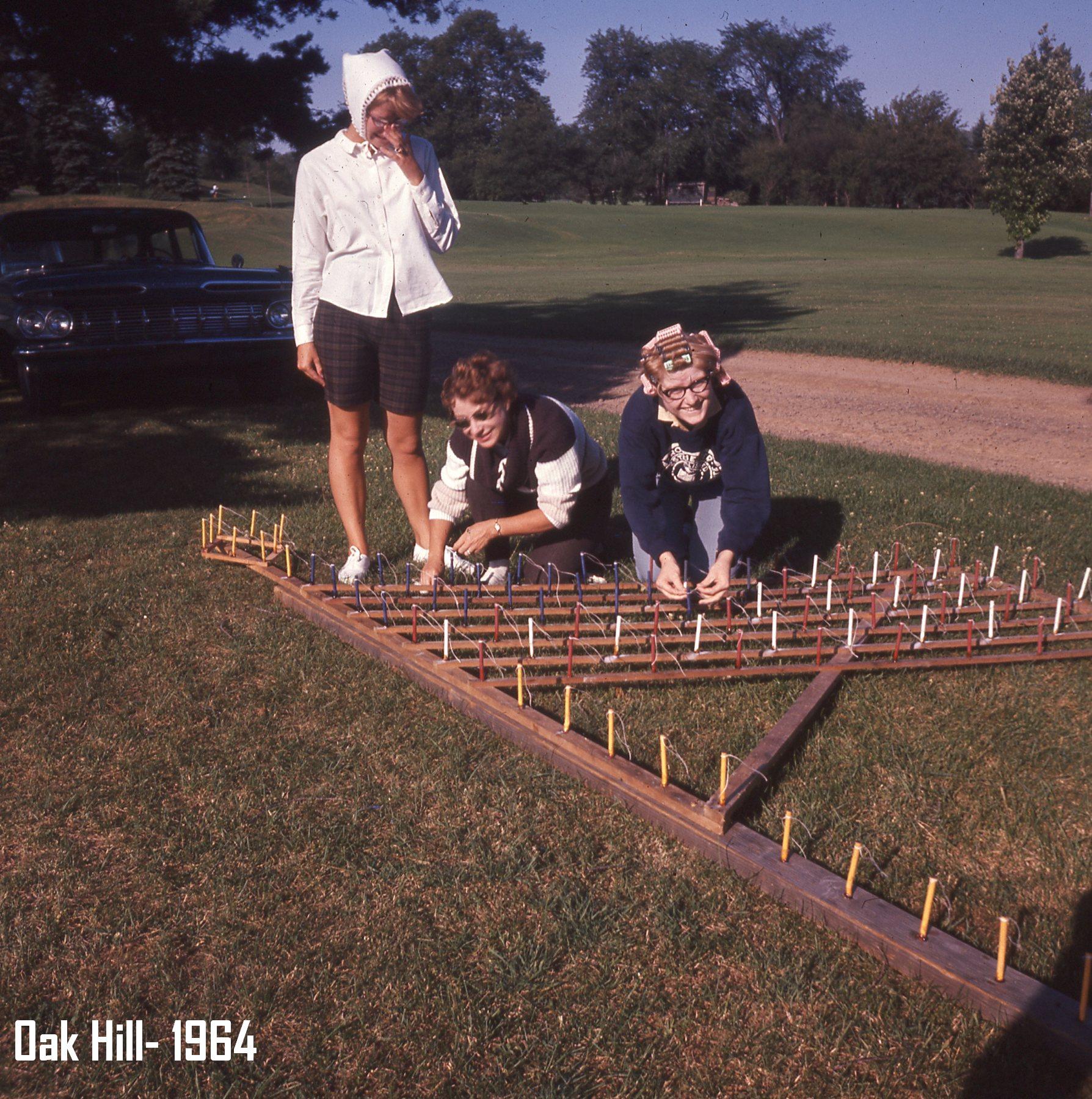 3 women assembling american flag fireworks