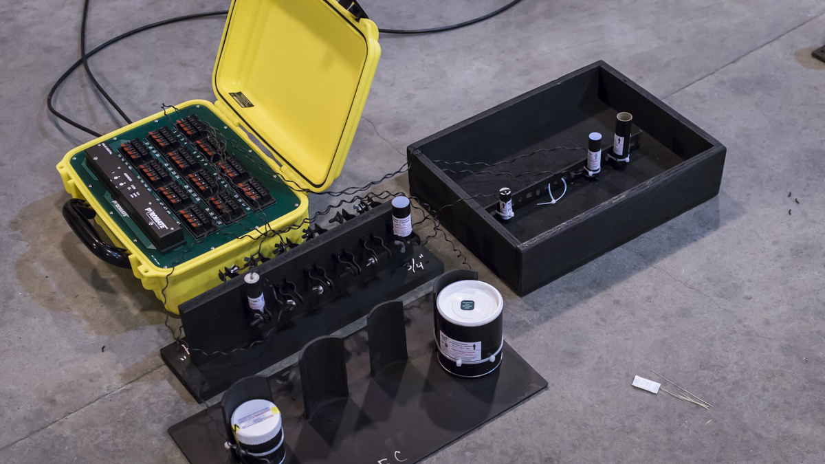 yellow electronic firing panel with wires connected to fireworks