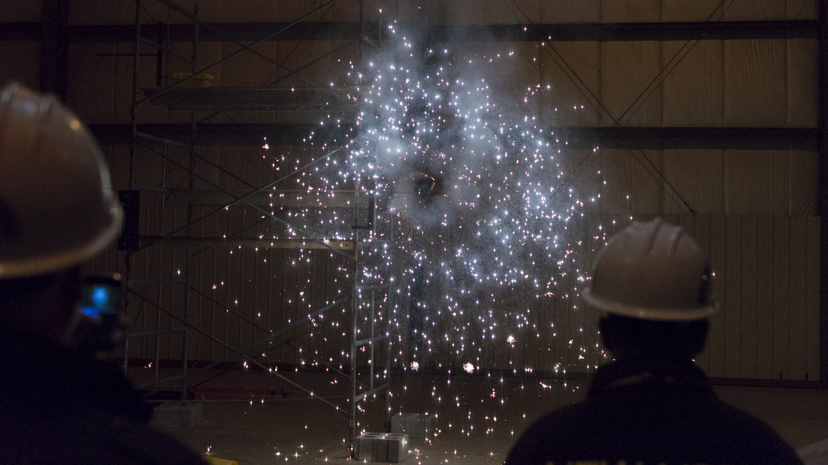 two people watching indoor fireworks